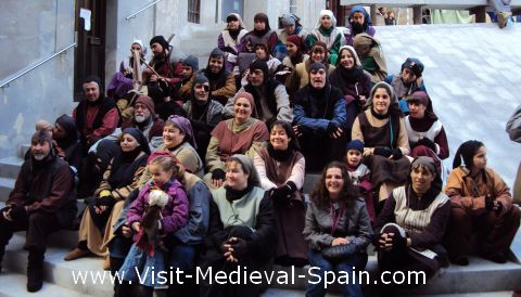 Participants in the Medieval Fair of Manresa 201 taking a well deserved break. Manresa, Catalonia, Spain