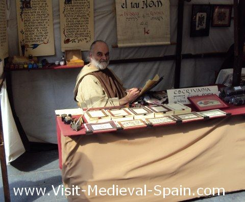 A Scribe in medieval dress sits at his stall awaiting his next customer in the 2011 Medieval Fair in Manresa, Catalonia Spain